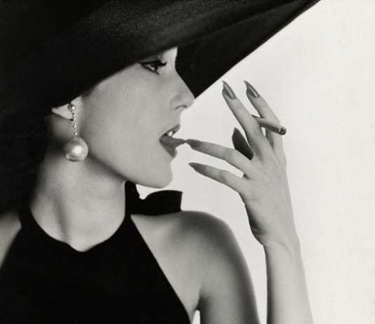 Irving Penn, Girl with Tobacco on Tongue (Mary Jane Russell) , New York, 1951. Courtesy The Metropolitan Museum of Art, New York, Promised Gift of The Irving Penn Foundation © Condé Nast.
